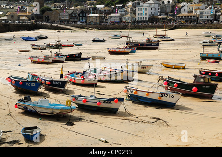 Boats seen at low tide in St Ives Harbour, Cornwall - Stock Photo