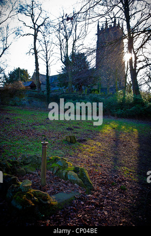Looking up towards St Mary's Church from Lymm Dam, Lymm, Cheshire, England with the sun behind the tower - Stock Photo