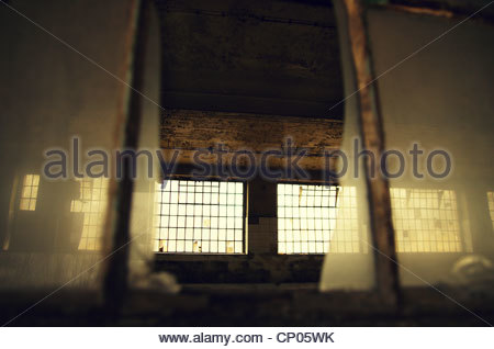 Looking into an old factory hall (former Red Army garrison town) - Stock Photo