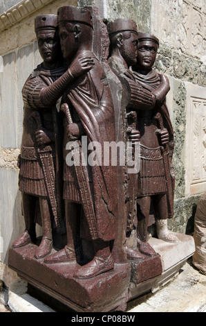 Sculpture of Four Tetrarchs near a gate in the Doge's Palace - sestiere San Marco, Venice - Italy The Portrait of - Stock Photo