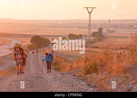 pilgrims on the Way of St. James having started from Santo Domingo de la Calzada with the sunrise, Spain, Basque - Stock Photo