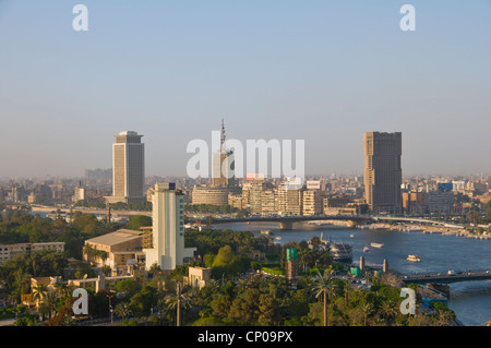 View of Nile river Opera complex gardens & downtown Cairo from Zamalek - Stock Photo