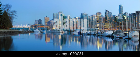 Vancouver BC City Skyline along False Creek by Stanley Park at Blue Hour - Stock Photo