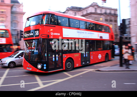 New bus for London in Piccadilly Circus - Stock Photo