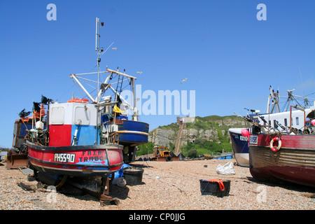 fishing boats on shingle beach Hastings East Sussex England UK - Stock Photo