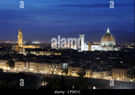 The Florentine skyline, including Florence Cathedral and the Palazzo Vecchio, at dusk, in Florence, Tuscany, Italy - Stock Photo