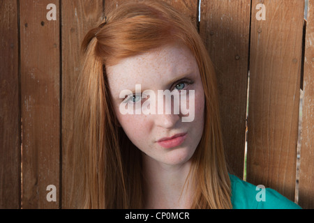 Fifteen year old girl looking confused. - Stock Photo