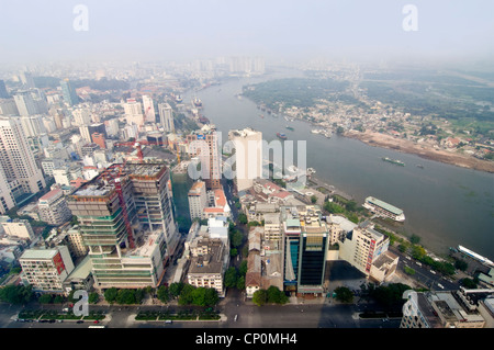 Horizontal northerly aerial view over the Saigon river and developing Ho Chi Minh City, Vietnam. - Stock Photo