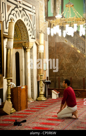 A Muslim worshiper prays in the Al-Ibrahimi Mosque in the Old City of Hebron. - Stock Photo