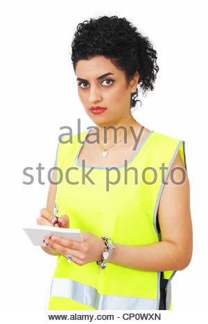 Female traffic warden writing a ticket - Stock Photo