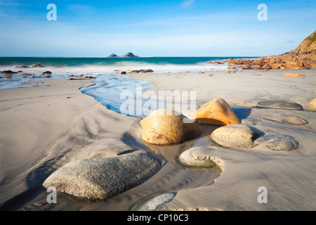 Porth Nanven Beach near St Just in Cornwall captured at low tide - Stock Photo