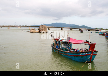Fishing boats in the harbour in Nha Trang, Vietnam. - Stock Photo