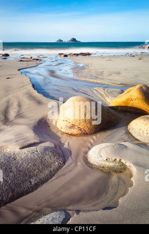 Porth Nanven Beach in Cornwall captured at low tide. - Stock Photo