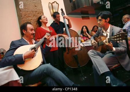 Concert in Clube de Fado, Singer Cristina Nóbrega & Clube de Fado owner / guitarist Mario Pacheco on the left, Lisbon, - Stock Photo