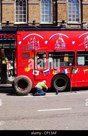 Tourist open-top bus tyre puncture repair, Baker Street, Marylebone, London, England, UK, Europe - Stock Photo