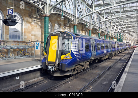 New Scotrail Class 380 EMU in Glasgow Central Station at platform 15 - Stock Photo