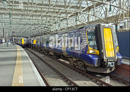 New Scotrail Class 380 EMU in Glasgow Central Station at platforms 12 and 13 - Stock Photo