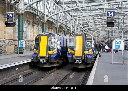 New Scotrail Class 380 EMU in Glasgow Central Station at platforms 14 and 15 - Stock Photo