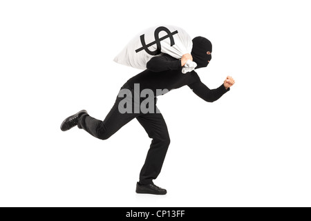 A thief carrying a bag and running away isolated against white background - Stock Photo