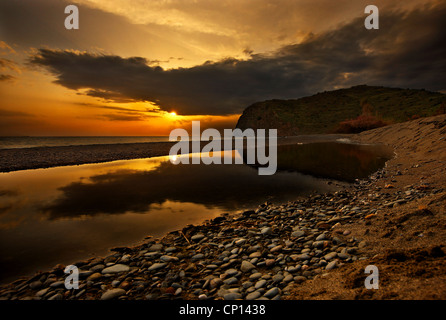Sunset at Agia Markella beach, close to Volissos, Chios island, Northeast Aegean, Greece - Stock Photo