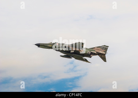 Army Fighter jet accelerating at 'Wings Over Houston' Air Show - Stock Photo