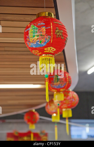 A row of hanging Chinese lanterns on display during a celebration of the 2012 Chinese Lunar New Year. - Stock Photo