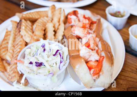 A lobster roll with fries and coleslaw at Lenny & Joe's Fish Tale, a seafood restaurant in Madison, Connecticut, - Stock Photo