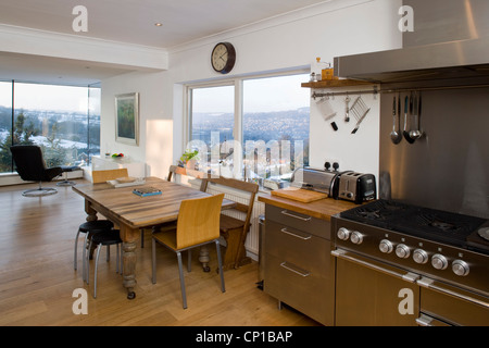 Open plan dining room and kitchen with view of Matlock, Derbyshire, UK. Evans Vettori Architects. - Stock Photo