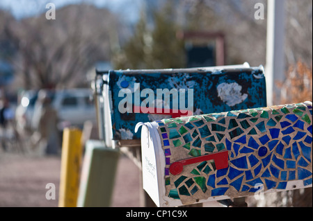 Detail of brightly decorated US style mailboxes in Madrid, New Mexico. - Stock Photo