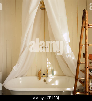 Old Fashioned Roll Top Bathtub With Shower Unit Above