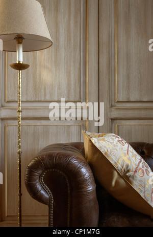 Leather Chesterfield sofa in Castel Monastero, Castelnuovo Berardenga, Tuscany, Italy. - Stock Photo