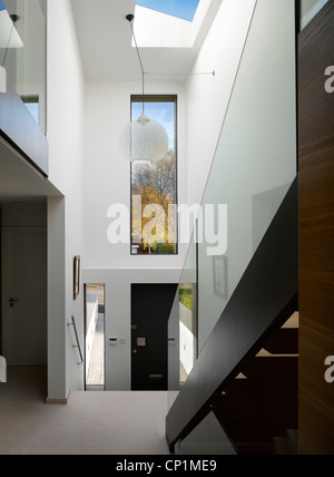 Double height entrance hallway to private house in Worsley, Salford, Greater Manchester, England, UK. - Stock Photo