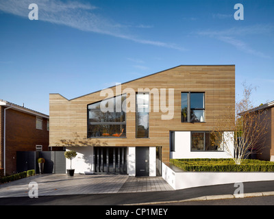 Timber cladding and driveway of building exterior of private house in Worsley, Salford, Greater Manchester, England, - Stock Photo