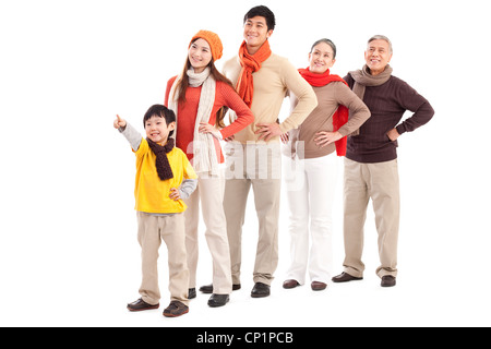 Family members looking afar and pointing the front - Stock Photo