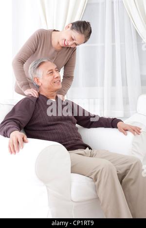 Happy senior couple doing message - Stock Photo