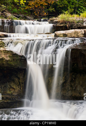 Indiana's Upper Cataract Falls pours through boulders with long exposure, silky smooth motion-blurred water. - Stock Photo