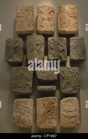 Black basalt relief. They are part of the 187 reliefs of the base of the south wall of the Palace of King Kapara. - Stock Photo