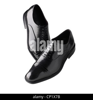 A still life shot of a pair of black mens shoes - Stock Photo