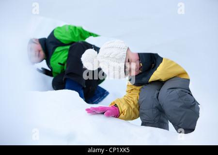 Cute children having fun in snow - Stock Photo