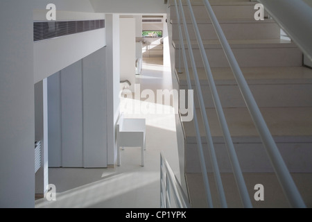 Pale wooden staircase above open plan interior, Rishpon, Israel, Architects: Architects: Irit Exselrod - Stock Photo
