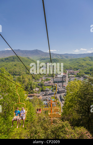 People on Sky Lift attraction in Gatlinburg, Tennessee in the Smoky Mountains - Stock Photo