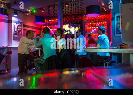 paris france men sharing drinks inside gay bar in the marais le stock photo royalty free. Black Bedroom Furniture Sets. Home Design Ideas