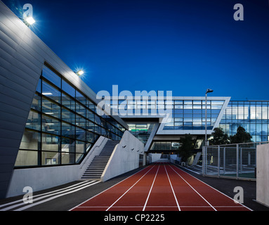 Night-time Exterior of athletics running track at Evelyn Grace Academy, Brixton, South London - Stock Photo