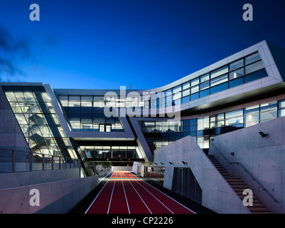 Night Exterior of Evelyn Grace Academy, a school by Zaha Hadid - Stock Photo