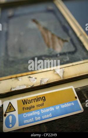 Danger Sign Warning Of Broken Glass On The Top Of A Wall
