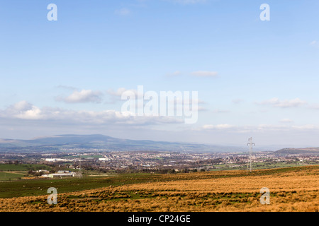 The western fringe of Oswaldtwistle moor in Lancashire looking towards Oswaldtwistle and the distant Pendle Hill. - Stock Photo