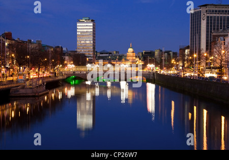 Dublin city at sunset with view over O'Connell Bridge and Liffey river. - Stock Photo