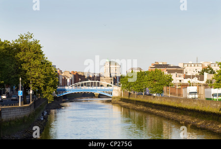 Dublin city at sunset - view over the Rory O'More and James Joyce's bridges and the Four Courts. On the Liffey river. - Stock Photo