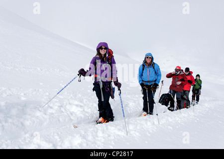 A group of happy skiers taking a break on the Haute Route - Stock Photo