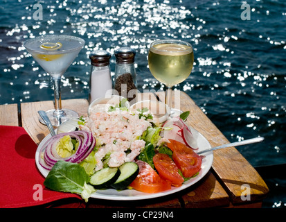 A Lovely Shrimp Louie Salad with a Martini and Wine at an Oceanside Restaurant on a Sparkling Summer Day - Stock Photo